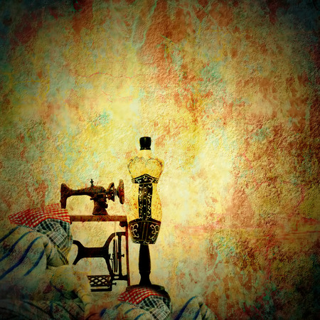 Woman mannequin and old sewing machine in grunge background with copy  space for text Stock Photo