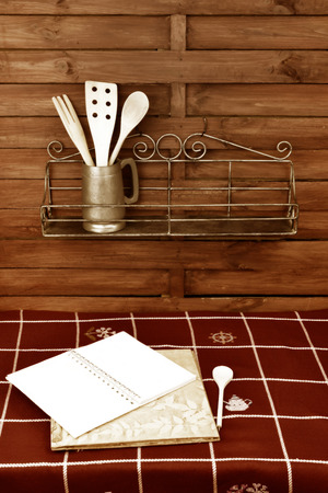 Blank book recipes and shelves with utensils rustic style photo