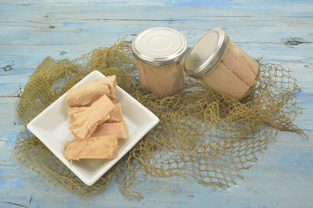 cantabrian: Cantabrian Sea Tuna, albacore in olive oil glass jar on wood table background