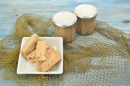tunafish: Cantabrian Sea Tuna, albacore in olive oil glass jar on wooden background