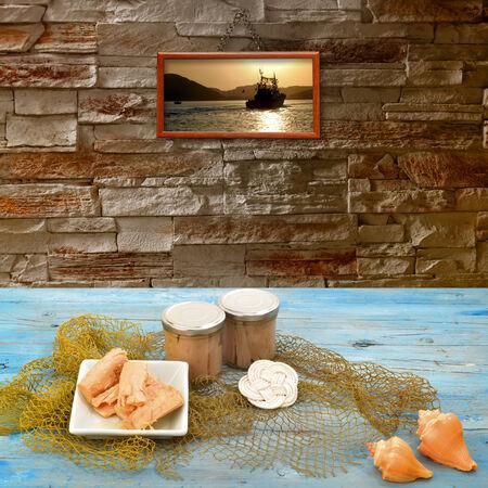 tunafish: Cantabrian Sea Tuna in olive oil conserves glass in rustic kitchen