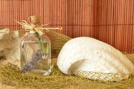 Lavender essential oil in glass jar on summer background photo