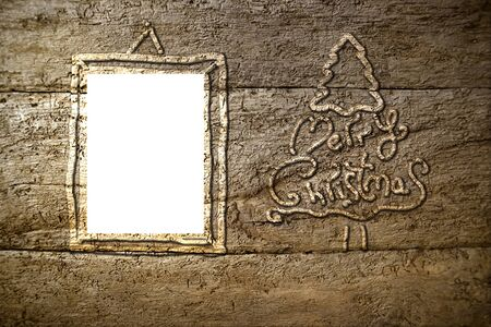 Christmas tree silhouette on old wooden background and frame for text or photo area photo