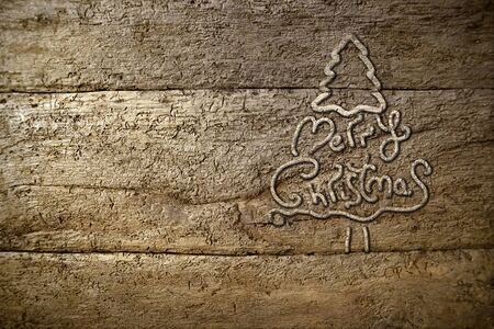 Christmas tree silhouette on old wooden background and text or photo area photo