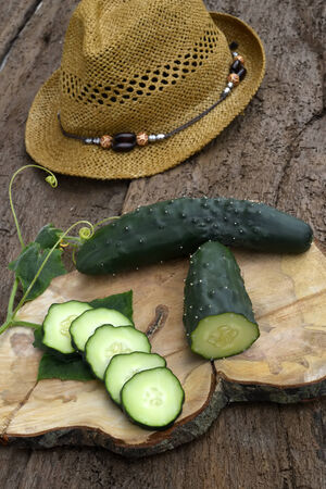 cuke: Cucumber organic garden on a old wooden table Stock Photo