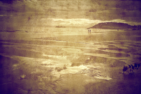 People walking on the beach in Santander Spain, in sepia tone photo photo