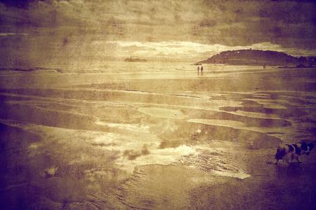 People walking on the beach in Santander Spain, in sepia tone photo photo