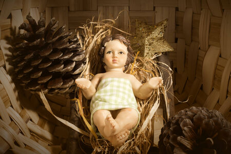 Christmas background, Baby Jesus in the crib on rustic background