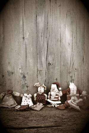Christmas card background with a space for text on a wooden surface and old rag dolls Santa Christmas photo