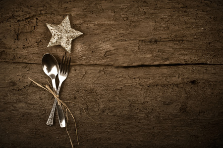 Christmas day dinner with table setting  star in rustic wood style with cutlery