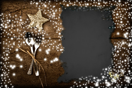 christmas catering: Background for writing the Christmas menu, parchment on old wooden table with stars
