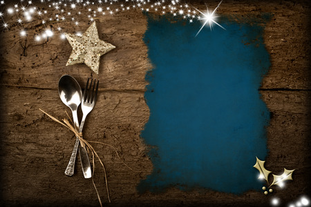 Background for writing the Christmas menu, parchment on old wooden table and Christmas decorations
