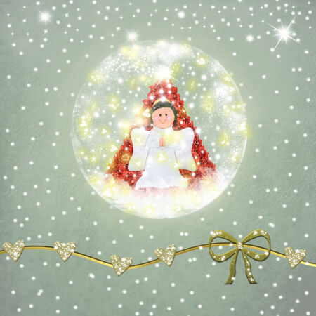 snowball: Snowball glass with an angel and a Christmas tree inside on a textured and gold ornaments Stock Photo