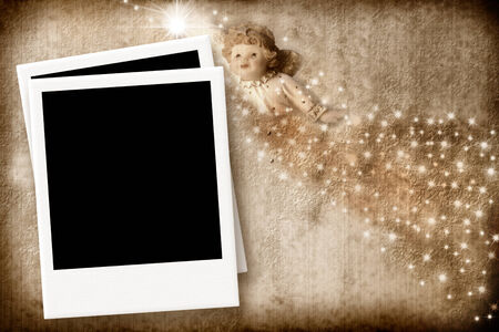 Angel Christmas Card with empty picture frame on a background of parchment photo