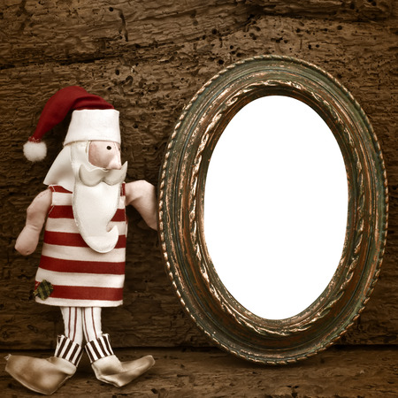 Greeting Christmas Santa Claus, old empty photo frame on wooden background photo
