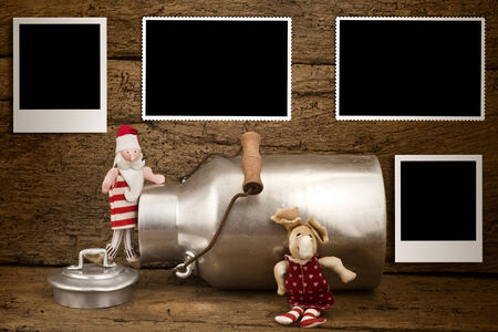 Christmas photos frames card, Funny Santa and reindeer  with four empty photos  frames hanging on old wooden wall photo