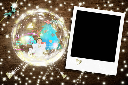 snapshot: Photo frame Chistmas greeting card, Angel into a crystal ball and empty frame snapshot