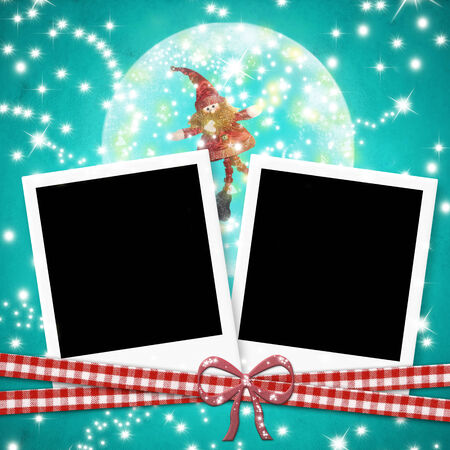 Christmas cards photo frames, two instant photo frames and cute elf within a ball  on blue  paper background photo