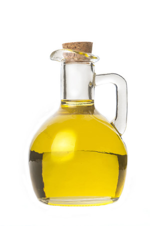 cooking oil: Extra virgin olive oil, a glass with olive oil isolated on white background Stock Photo