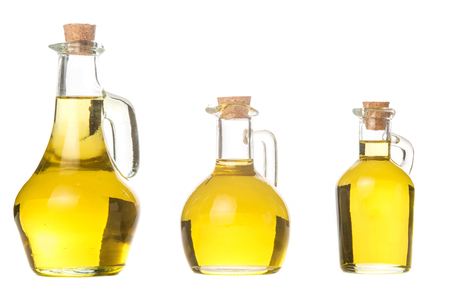 Extra virgin olive oil three glass jars with olive oil isolated on white background