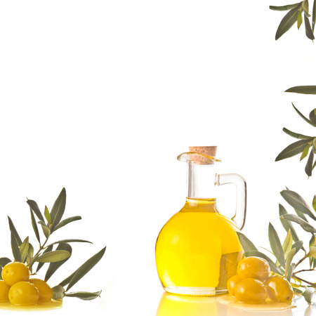 extra virgin olive oil: Cruet with extra olive oil, olives and olive branches on white background with blank space for text entry
