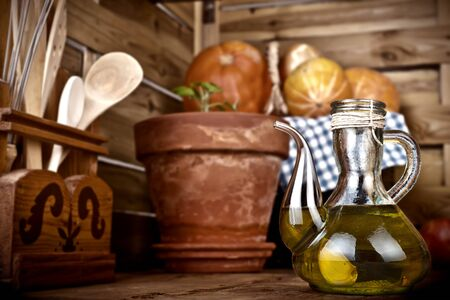 flavored: Olive oil flavored with garlic on a wooden kitchen Stock Photo