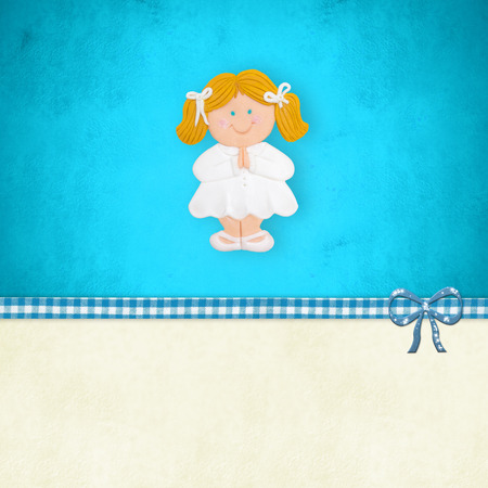 customization: My First Holy Communion invitation card, blonde girl praying  on blue background with blank space for customization Stock Photo