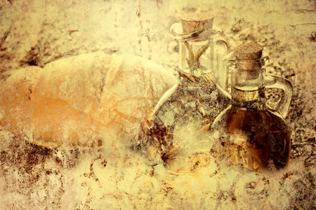 additional: Extra virgin olive oil and bread on vintage background