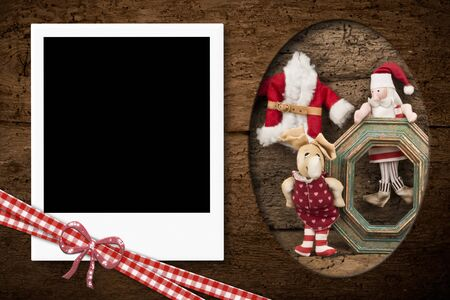 christmas photo frame: Instant photo frame on the wooden texture with Christmas decoration Santa