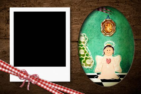 one year old: Instant photo frame on the wooden texture with Christmas decoration