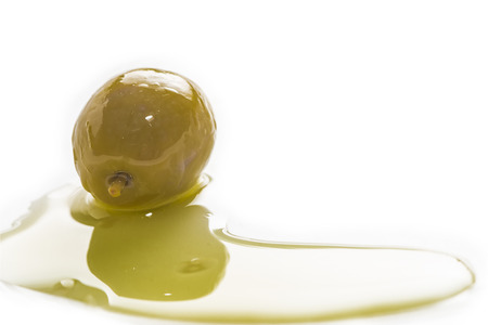 Green olives and olive oil isolated on white background