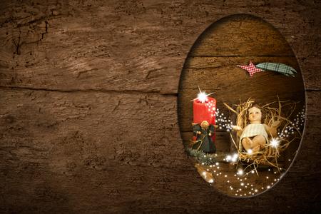 Postales de Navidad, Niño Jesús y el espacio vacío para escribir mensajes o poner fotos en el fondo rústico Foto de archivo