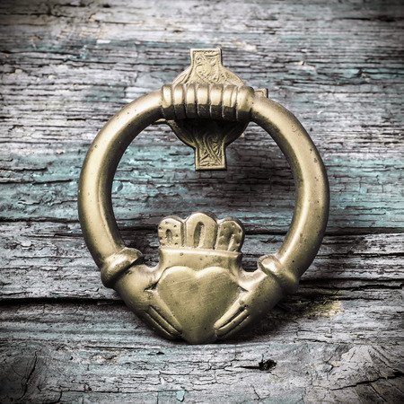 Claddagh, irish symbol of love, friendship and loyalty in old wooden background 免版税图像 - 49922674