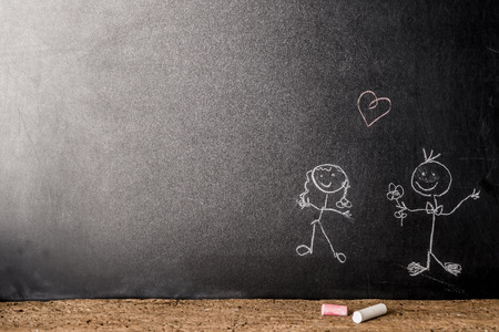 space for writing: Valentines day,  couple in love stick figure drawn with chalk on a blackboard with copy space  for writing or put photo Stock Photo
