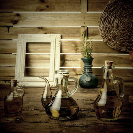 varieties: Varieties of olive oil in rustic kitchen