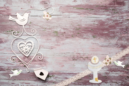 First Communion invitation card, religious symbol on wooden background with copy space to put photo and text