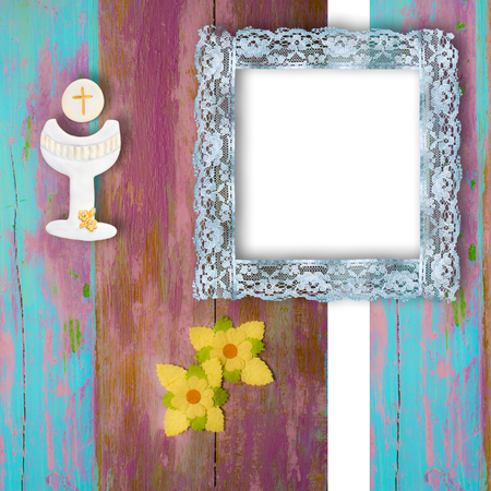 chalice: First Holy Communion photo frame invitation, chalice and flowers on wooden background