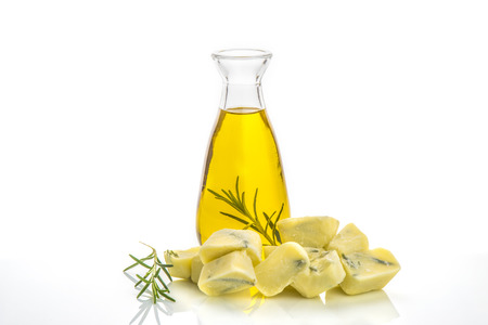 flavored: Extra virgin olive oil flavored with rosemary preserved frozen and olive oil glass bottle isolated Stock Photo