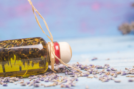 flavored: Lavender oil, olive oil flavored with seeds and lavender flowers on wooden table