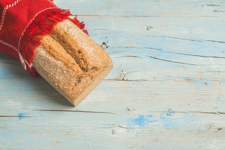 artisan bakery: Artisan spelled flour bread on wooden table with empty space Stock Photo