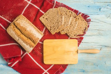 spelt: Spelt bread slices on rustic kitchen table