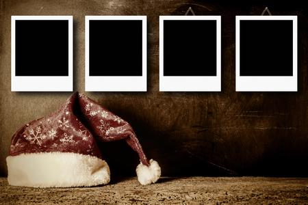 Christmas cards, vintage Santa hat with empty picture frame for put four photos and empty space for message