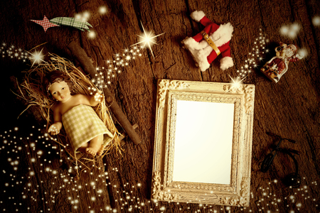 sparking: Close up top view of empty photo frame and Christmas decorations on wooden surface among sparking stars. Copyspace.