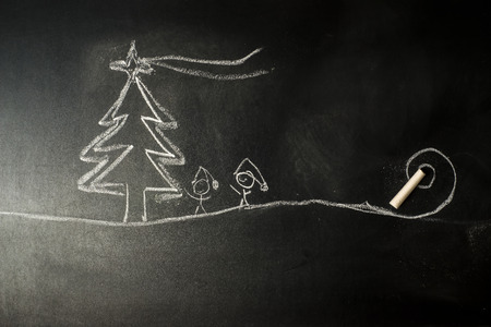 Funny Christmas Greeting Card, Christmas tree and stickman children drawing in a blackboard with copy space for message