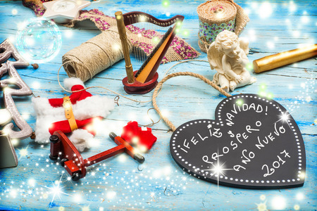good wishes: Christmas greetings card, Christmas ornaments and good wishes message 2017 in Spanish Language , magic atmosphere Stock Photo