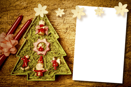 Chtistmas letters, cute Christmas tree, candles and flowers with  blank paper for write mesaage.