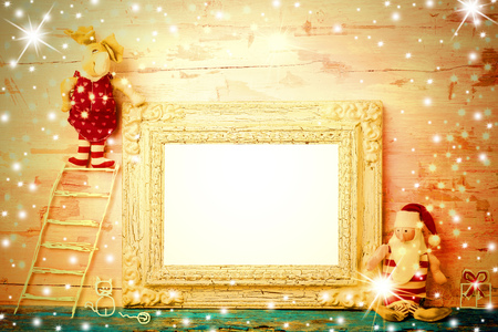 rag doll: Cheerful empty photo frame Christmas card, vintage Santa Claus rag doll and reindeer climbed on a ladder drawn by a child