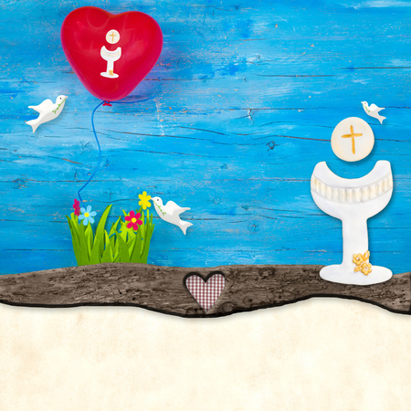 First Holy Communion invitation card.Chalice, doves and balloon on blue wooden table , copy space to write text. Stock Photo