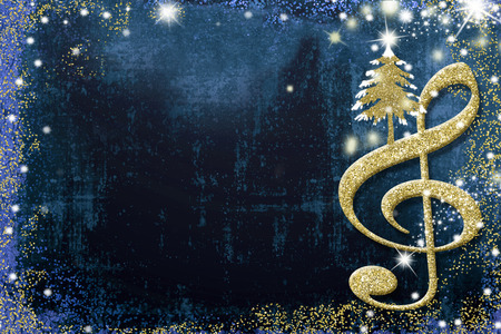 Christmas musical card.Treble clef and Christmas tree golden glitter texture on blue background with copy space.