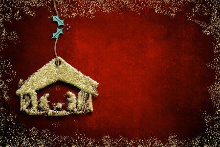 Weihnachtskrippengrußkarten, abstrakte freihändige Zeichnung der Krippe mit dem goldenen Funkeln, das am roten leeren Hintergrund hängt. Standard-Bild